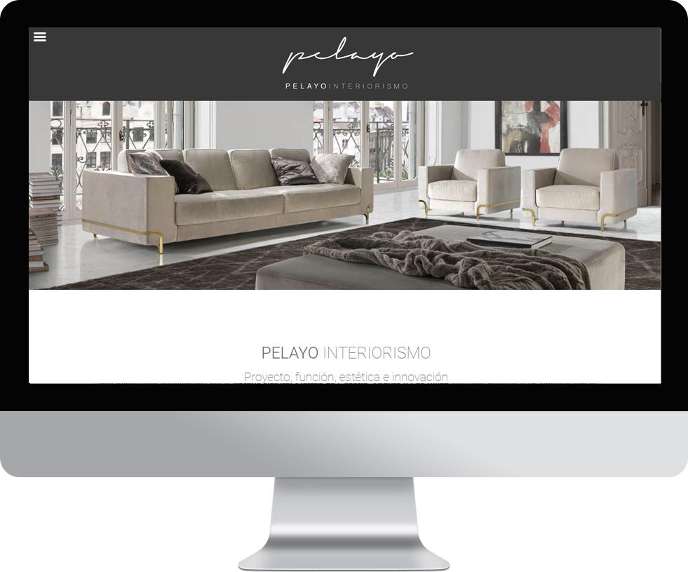 Trabajo web para Pelayo Interiorismo en pantalla grande